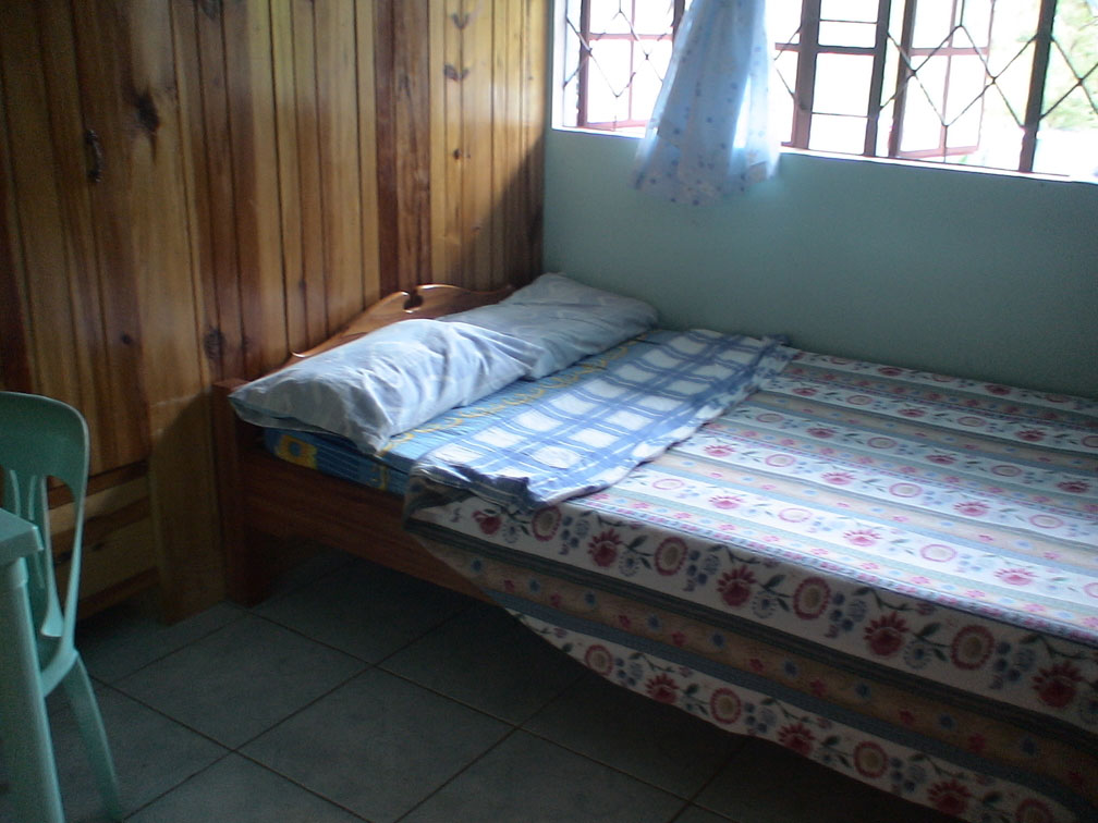 Bedroom With Balcony And Bathroom